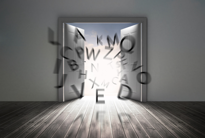 Doors opening to show flying letters in a grey room